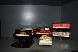A selection of musical piano shaped boxes.