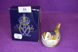 A Royal Crown Derby Firecrest paper weight having gold stopper,with box.