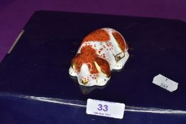A Royal Crown Derby puppy paper weight having gold stopper,with box.