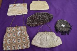 A collection of vintage evening bags, beaded and embroidered examples amongst this lot,