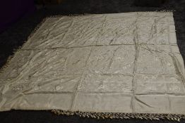 An early 1920s Chinese bed throw having tassels to edge.