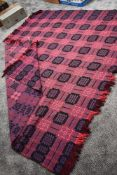 A large Welsh pure new wool blanket in vibrant purple, black and cerise.