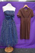Two 1950s vintage dresses,one strapless dress having flocked white dots to tulle overlay,full