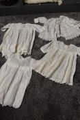Four items of early 20th century baby clothing,including fine muslin jacket with fine embroidery.