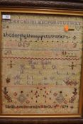 A Victorian embroidered sampler having biblical quote,alphabet and more by Sarah Ann Bowman March