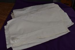 A selection of vintage white flat sheets.