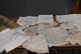 A collection of modern damask table cloths and vintage and antique examples having deep crotchet