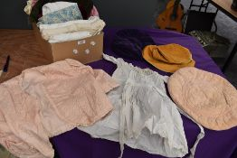 A mixed collection of vintage and antique items including childrens gowns,bed jackets, hats and