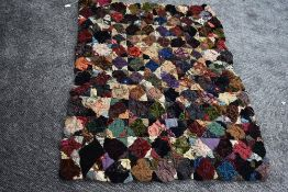 An unusual throw/quilt having a variety of raised sections of fabric, around mid to late 19th