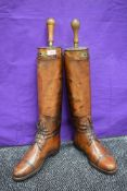 A pair of antique tan leather boots with boots trees,made my Bartley and Sons,London(1885-1920)Owned