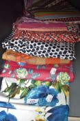 A selection of vintage fabrics, good quantities of each and in various colours, predominantly 60s