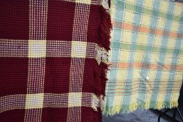 A lovely bright vintage waffle blanket in red and yellow and another blanket having check pattern.