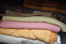 Seven vintage and retro bed covers,throws and blankets.