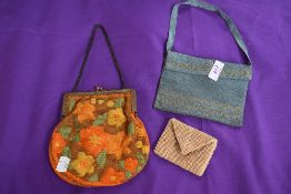 Two vintage evening bags, one having colourful embroidery with clasp frame,and the other in a blue