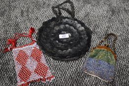 A trio of vintage and antique handbags including circular leather bag in black and two smaller