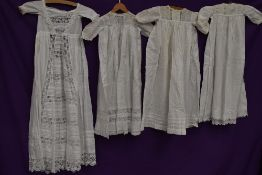 Four late 19th and early 20th century baby gowns and dresses, some incredible techniques an