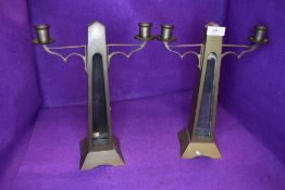 A pair of antique brass candle stick holder with glass inserts to front(currently loose and will