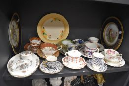 A mixed lot of vintage ceramics including highly decorated cups and saucers, plates and more.