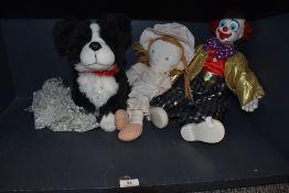 A retro clown, a rag doll and a cuddly toy dog.