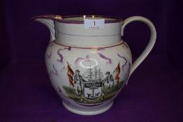 A large Victorian Sunderland ware lustre jug having quotation to reverse,bridge scene under spout