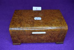 A vintage maple veneered box having two internal compartments.