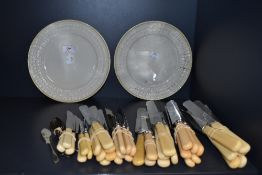 A selection of vintage flat ware and two Belleek plates.
