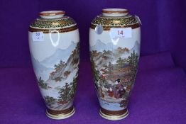 A pair of highly decorated Japanese satsuma vases.