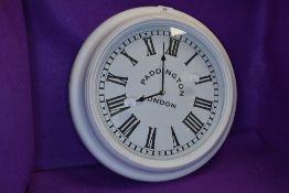 A vintage style Paddington London wall clock.