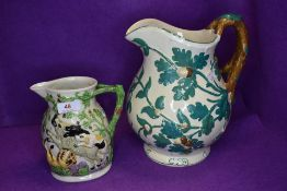 Two vintage Masons jugs, one having scene of animals attacking each other, the other having oak leaf