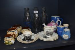 A collection of vintage Souvenir items from Sedbergh and Hawes, and three milk bottles.