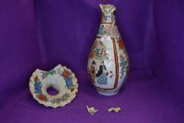 An antique Chinese hand painted porcelain vase having baluster form with scalloped rim,in need of