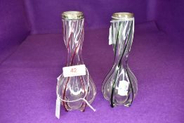 Two vintage vases having having colourful twists throughout and silver bands to necks.