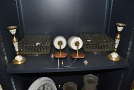 A selection of vintage lamps and shades and two candle sticks.