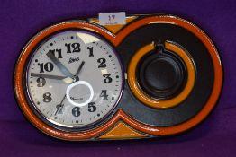A German 1970s Schatz Elexacta ceramic wall clock,having brown and orange ground.