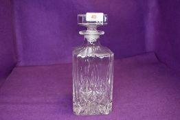 A vintage glass decanter.
