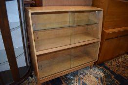 A mid 20th Century golden oak bookcase having glazed sloped front, width approx. 91cm