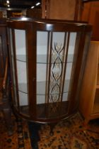 A mid 20th Century stained frame demi lune display cabinet
