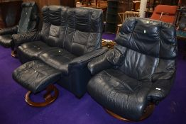 A Stressless suite comprising settee, two chairs and single footstool