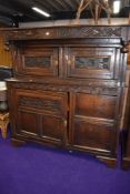 A period oak court cupboard, bears carved date 1697, further foliate and florette carving, width