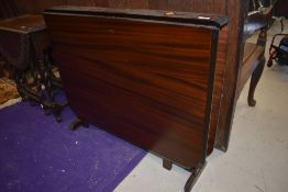 A vintage mahogany sutherland style dining table, width approx. 91cm