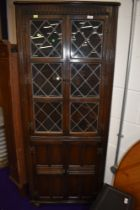 An Old Charm or Priory style dark stained corner display