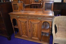 A light mahogany and inlaid chiffoneir or sideboard base, stamped Gillow and Co, dimensions