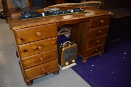 A modern pine dressing table, having four drawers to each side and ledge back, width approx. 125cm