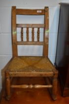A 19th Century childrens spindle back rocking chair