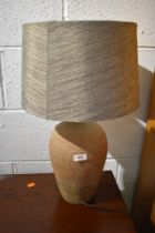 A pottery table lamp, with complimentary shade