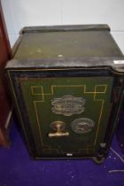 A vintage wrought iron safe, with brass plate for George Titterton, Birmingham, approx 39 x 56 x