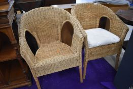 A pair of wicker tub chairs