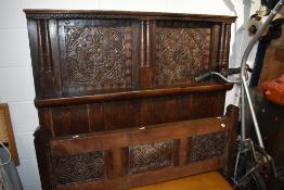 A Period oak carved panel bed head and foot