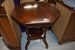 A late 19th/early 20th Century mahogany octagonal occasional table on part turned legs with