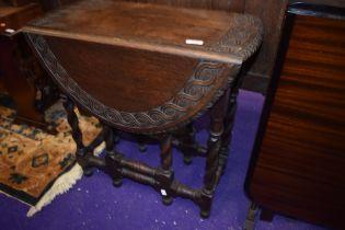 An early 20th Century oak twist gateleg occasional table